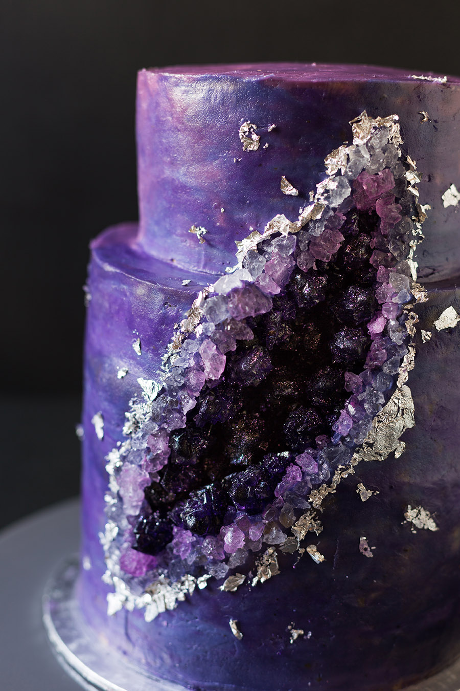 Close up of the purple geode cake with rock candy sugar crystals and silver leaf