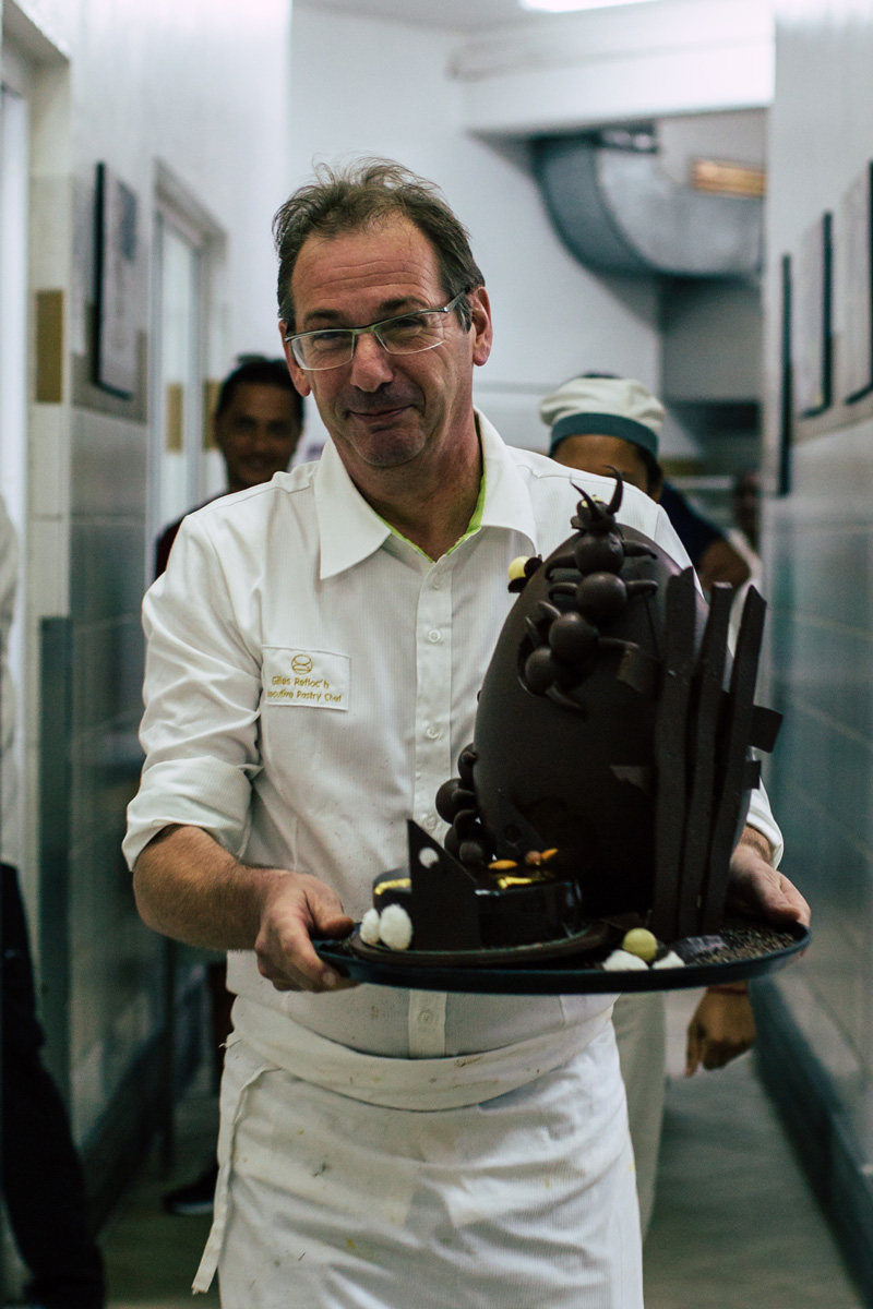 Pastry chef with chocolate sculpture