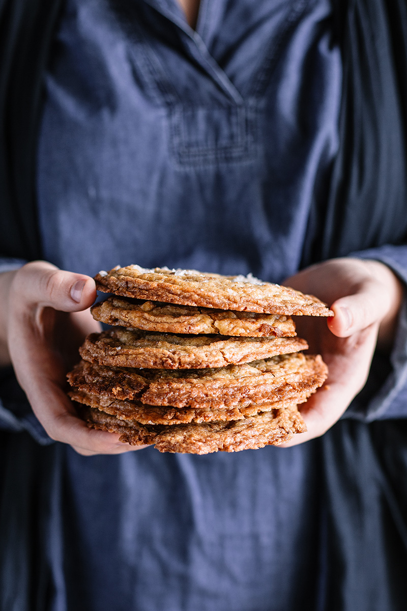 Woman holding a stack of pan-bang cookies