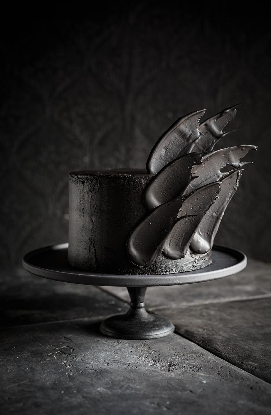 Black Brushstroke cake with layers of black velvet sponge, burnt vanilla buttercream and chocolate brushstrokes