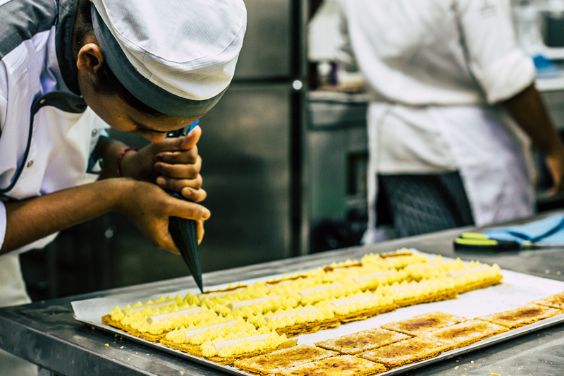 Pastry chef prepping mille feuille